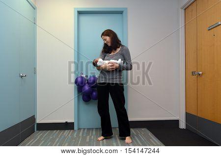 Mother Holds Her Newborn Baby
