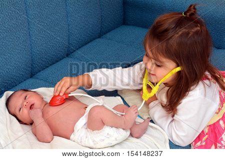 Little Girl And Newborn Sister
