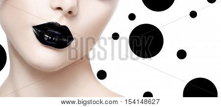 Beauty Fashion Model Girl face with Black lipstick Make up. Fashion Trendy Black lips. Dark Lipstick, white skin. Isolated on white background