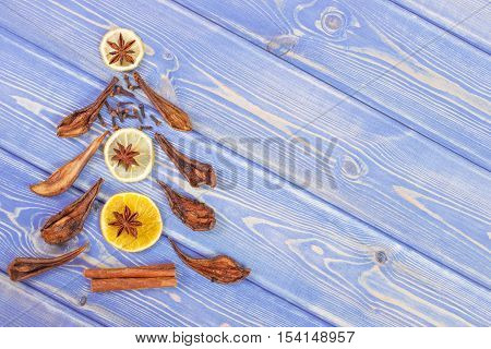 Christmas Tree Shape Made Of Dried Fruits And Spices On Wooden Boards, Copy Space For Text