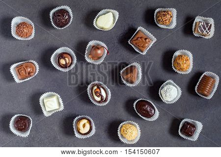 Delicious chocolates, praline and bonbons. Chocolate candy pattern. Top view, horizontal