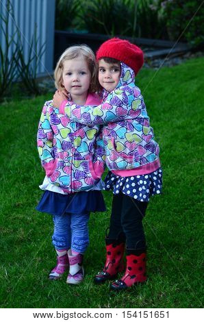 Two Little Girls Huges Outdoor