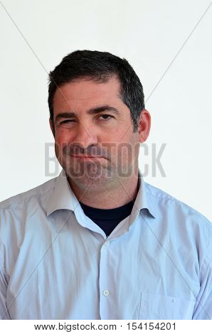 Man disagree face expression. Male emotional expression on white background. Concept photo of challenge opposed argue debate dispute not believing.