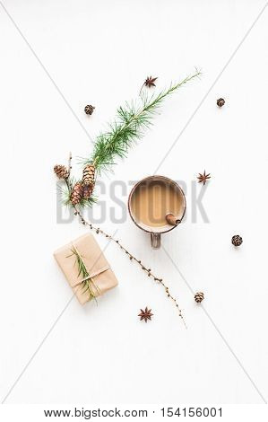 Christmas composition. Cup of coffee larch branches cinnamon sticks anise star. christmas gift. Flat lay top view