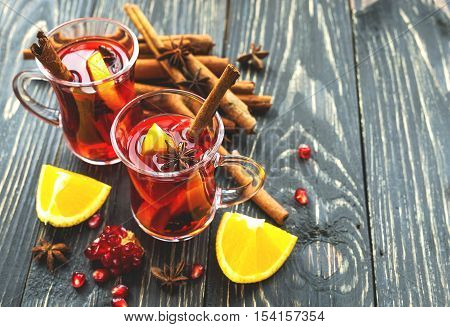 Hot Mulled Wine With Apples, Pomegranate, Orange, Anise And Cinnamon