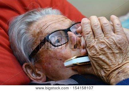Old Man Play Harmonica