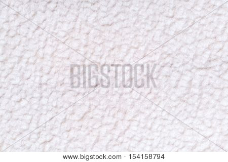 White fluffy background of soft fleecy cloth. Texture of textile closeup