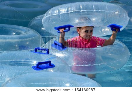 Child Play With Inflatable Clear Inner Tubes