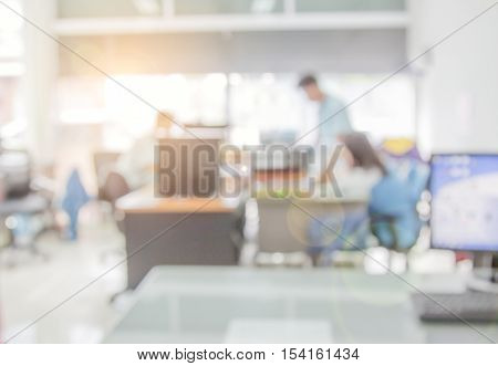 Businessmen blur in the workplace.Table work Top And Blur Office with computer of Background.Abstract shallow depth of focus.education.