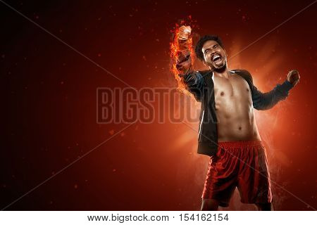 Asian Boxer Punching With Flame Around His Arm