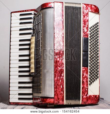 Mother Of Pearl Accordion On A Gray Background