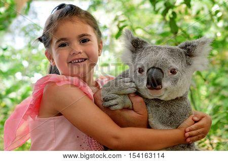 Little Girl Hugs Koala