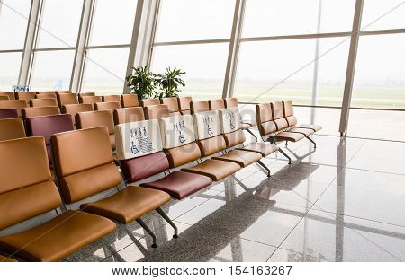 Waiting area at airport gate. Seats for persons with disability. Empty departure lounge. Waiting to board.