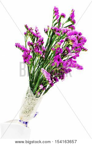 Bouquet from purple statice flowers in vase isolated on white background. Closeup.
