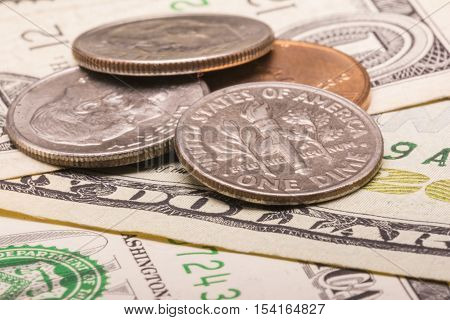 US Dollar money: Macro view of euro coin and bill with the word dollar focused. Suitable for financial, monetary, economic concepts and ideas