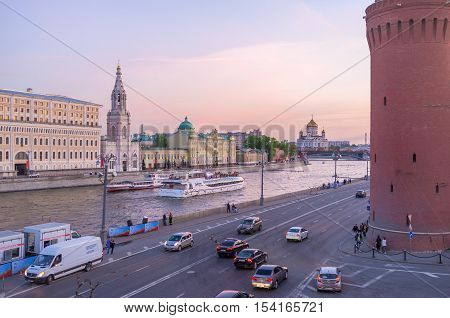 MOSCOW RUSSIA - MAY 10 2015: The sunset sky over the Moskva river with a view on Sofiyskaya embankment and Cathedral of Christ the Savior on the distance on May 10 in Moscow.