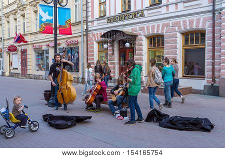 MOSCOW RUSSIA - MAY 10 2015: The string quartet in Arbat street plays for tourist and locals on May 10 in Moscow.