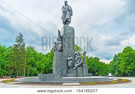 KHARKOV UKRAINE - MAY 20 2016: The great monument to Taras Shevchenko surrounded by the flowerbeds and lush greenery of the city gaden named in his honor  on May 20 in Kharkov.