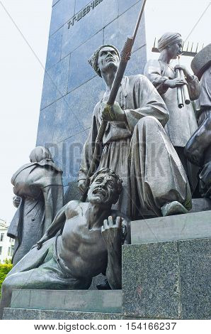 KHARKOV UKRAINE - MAY 20 2016: The sculptures of dying Gaydamak and Gaydamak with a scythe - the characters from poems of Taras Shevchenko located at the foot of his Monument in Kharkov  on May 20 in Kharkov.