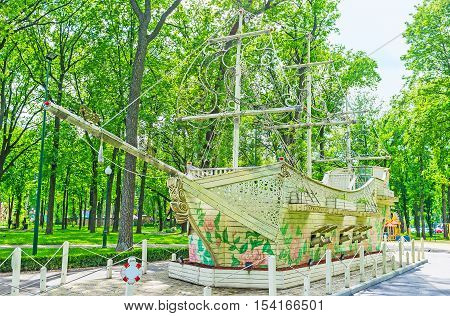 KHARKOV UKRAINE - MAY 20 2016: The old warship covered with colorful roses in Gorky Park of Kharkov  on May 20 in Kharkov.