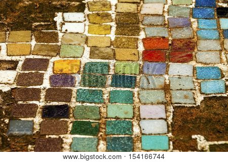 Colorful  Old Mosiac Tiles On Sandy Outdoor Garden Path