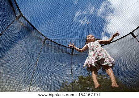 Little Girl Jumps On A Trampolin
