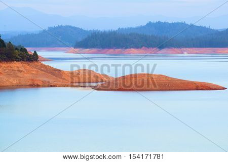 Shasta Lake Reservoir which has low water levels caused from the California Drought taken in Northern California