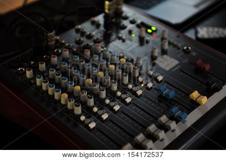 DJ console mixing desk on a table