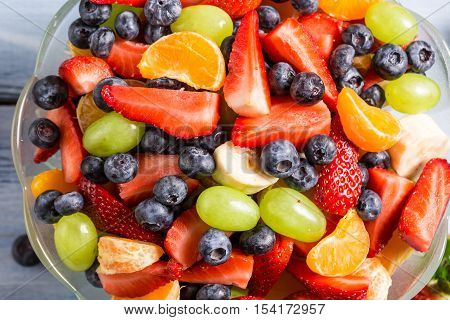 Closeup of fresh healthy salad made of berry fruits