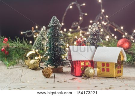 christmas decorations with baubles,tree and toy house.