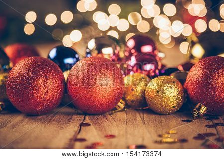 studio shot of group of colorful baubles on wooden table.