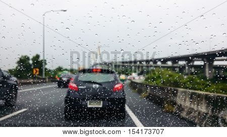 The Rain Drop On The Windscreen Car On The Road