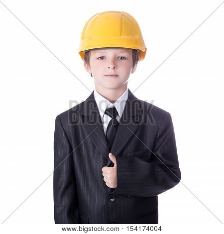 Portrait Of Little Boy In Business Suit And Builder's Helmet Isolated On White