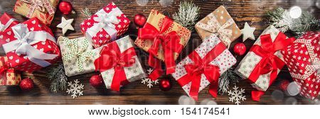 Christmas gift boxes placed on wooden planks in panoramatic composition