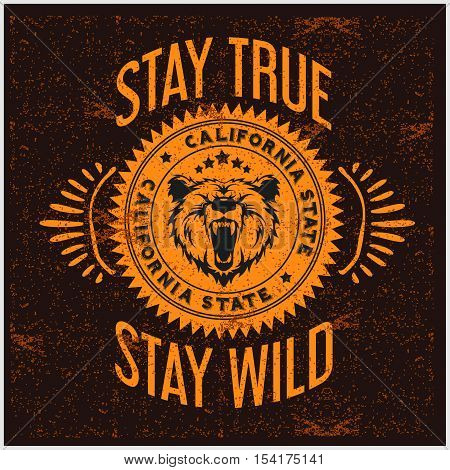 Wild and Free vintage typography with a head of a grizzly Bear, t-shirt print graphics on grunge background