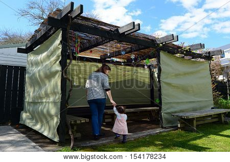 Jewish Woman And Child Visiting Their Family Sukkah