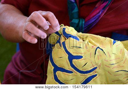 Woman Sewing A Tivaevae