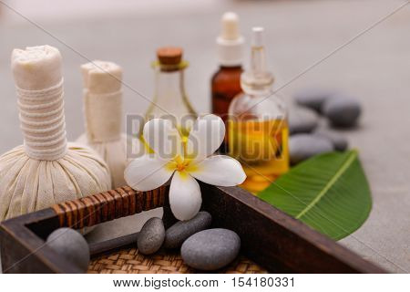 Spa and wellness treatment setup on gray background