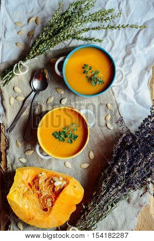 Pumpkin Porridge And Pumpkins On Black Wooden Table. Plate Pumpk