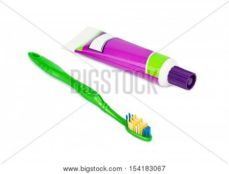 Toothbrush and paste tube isolated on white background