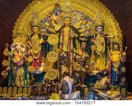 KOLKATA, INDIA - OCTOBER 8, 2016:Durga Puja Festival Kolkata, West Bengal. Priests offering puja to Durga idol at a South Kolkata Durga pandal on Ashtami (3rd day) of Durga Puja.
