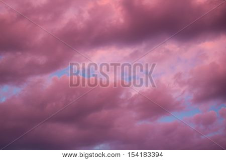 Colourful Skyscape With Purple Clouds At Sudown Dusk