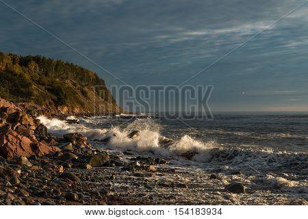 Ocean shore at sunrise (Cabot Trail Cape Breton Nova Scotia Canada)