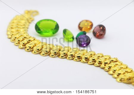 jewelry and precious stone on the white background,  Gold bracelet on the white background,jewelry and precious stone