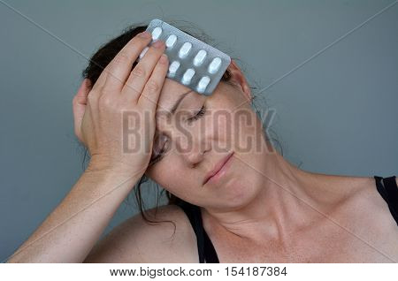 Woman Having Headache Taking Pills