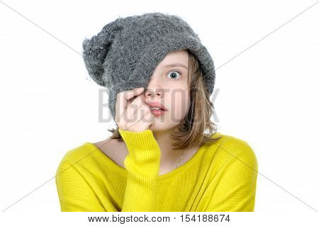 Frightened Teen Girl Covers Her Face With A Cap..