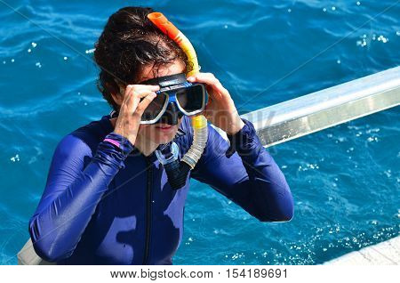 Woman prepare to snorkeling dive in the Great Barrier Reef Queensland Australia