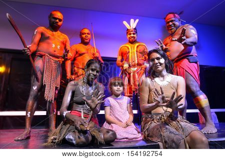 Little girl (age 05) photographed with Native Australian Yirrganydji Aboriginal people during cultural show in Queensland Australia