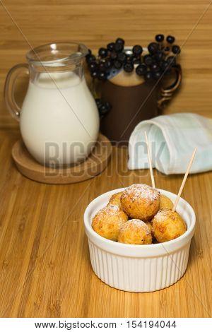 Cottage cheese balls in ramekin with milk