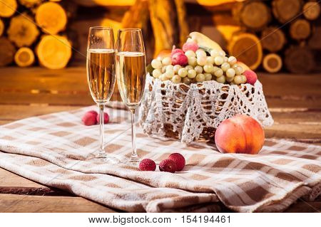 Two Glasses Of White Wine And Juicy Fruits In The Wicker Basket